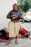 man in traditional dress playing a Charango