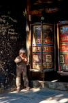 small boy and prayer wheels