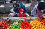 man and child, selling vegetables and fruit