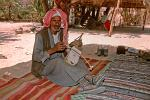 Bedouin man playing a violin like instrument, Sinai Desert