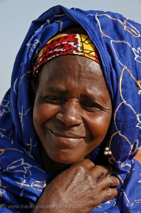 local woman with a colourful headscarf