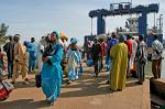 people in colourful dress at the ferry, Banjul