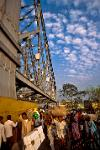 people crossing Howrah Bridge over the Hooghly River