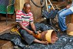 man making a Djembe at the arts and crafts market