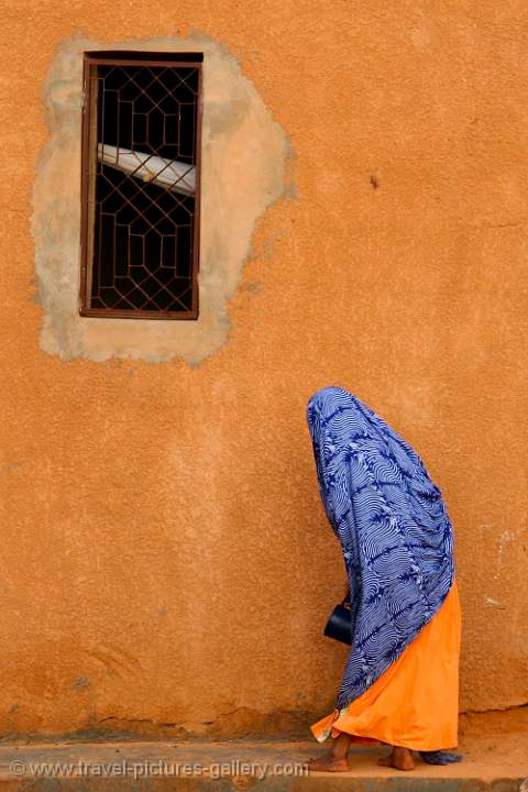 ochre wall and colourful dress