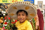boy posing with a sombrero