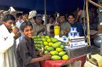 friendly local people at a mango juice bar, bazar