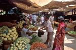 people buying vegetables, market scene