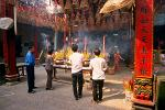 people worshipping at a Cholon temple