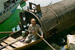 elderly man on his Sampan