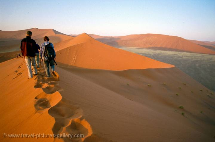 climbing the sand dunes of the Namib Desert